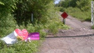 Cards and a stuffed animal have been placed at the site where the 12-year-old was found after the stabbing.