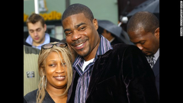 "Actor Tracy Morgan and his wife Sabina pose on the red carpet during the premiere of ""Are We There Yet?"" at the Mann Village on January 9, 2005 in Los Angeles. The couple divorced in 2009 after 23 years of marriage."