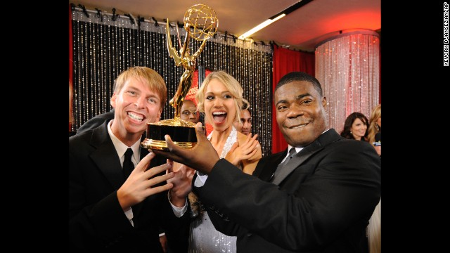 "Members of the cast of ""30 Rock"" joke around with their award for outstanding comedy series backstage at the 60th Primetime Emmy Awards in Los Angeles on September 21, 2008. Morgan was also nominated for Outstanding Supporting Actor in a Comedy Series."