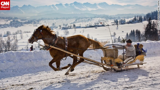 A sleigh rider is carried through the Malopolska region of <a href='http://www.poland.travel/en/nature/tatra-national-park' target='_blank'>Tatra National Park</a> in Poland. <a href='http://ireport.cnn.com/docs/DOC-1138891'>Adrian Lukas Smith took</a> this photo and works closely with the park. He says his favorite part of this region is the landscape and the Tatra Mountains, which are a natural border between Poland and Slovakia.