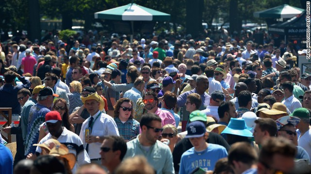 Fans make their way into Belmont Park prior to the Belmont Stakes.