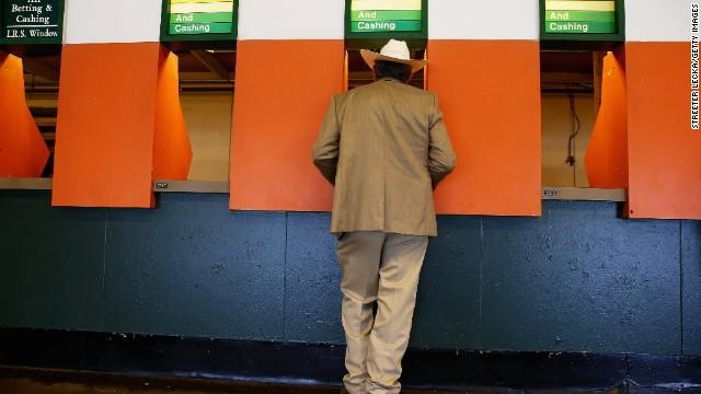 A fan places a bet at Belmont Park.