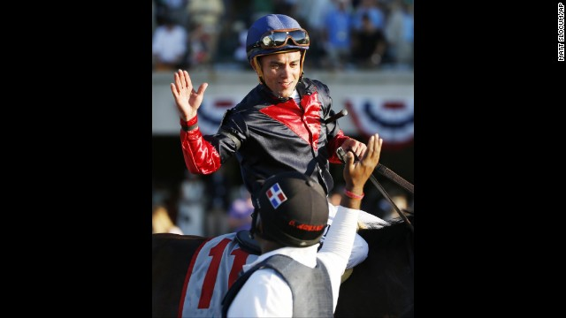 Jockey Joel Rosario is congratulated after riding Tonalist to victory.