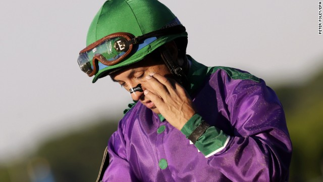 Victor Espinoza wipes his eye after finishing fourth aboard California Chrome.