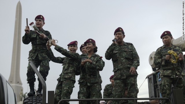 "Thai soldiers entertain people with songs at Victory Monument in Bangkok on Thursday, June 5. The junta is waging a propaganda campaign to encourage ""national happiness"" following the coup that severely restricted civil liberties."