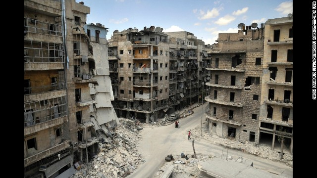 "Apartments and other buildings lie in ruins on Tuesday, June 3, in Aleppo, a city that ""has had the life bombed out of it,"" according to CNN's Nick Paton Walsh."