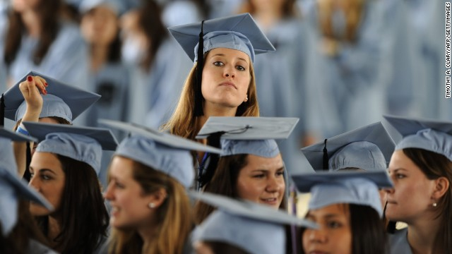 Graduates wait to hear U.S. President Barack Obama, at Barnard College's graduation ceremony in New York May 14, 2012.