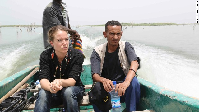 CNN's Arwa Damon (L) heads out on Lake Chad. Islands now cover half of the once-massive lake as its waters continue to recede. U.S. and Nigerian security sources say the lake is an area of interest in the search for the missing Nigerian schoolgirls.