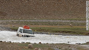 Four-wheel drive river crossing near India\'s frontier.