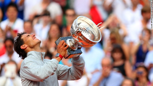 Rafael Nadal celebrates with the Musketeers' Trophy after defeating Novak Djokovic in the French Open final Sunday, June 8, in Paris. Nadal, the top-ranked tennis player in the world, has now won 14 major tournaments and nine of the last 10 French Opens.