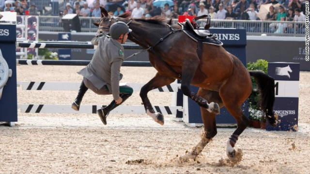 Show jumper Emanuele Gaudiano struggles with his horse, Cocoshynsky, during a Longines Global Champions Tour event in Shanghai, China, on Thursday, June 5.