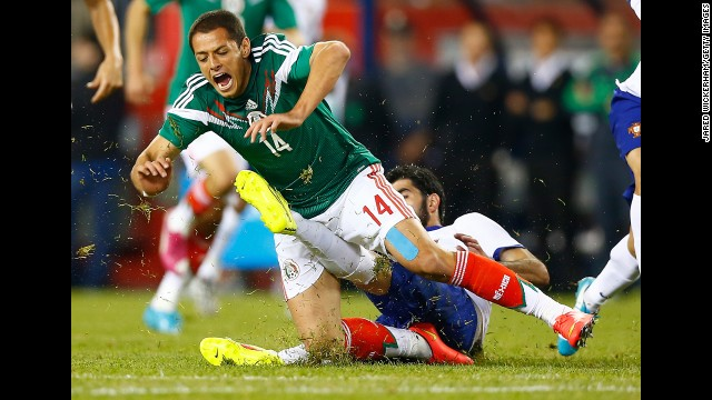 Mexico's Javier Hernandez is fouled by Portugal's Neto during an international friendly match Friday, June 6, in Foxborough, Massachusetts. Portugal won 1-0 on a goal by Bruno Alves. Both teams will be playing in the World Cup.