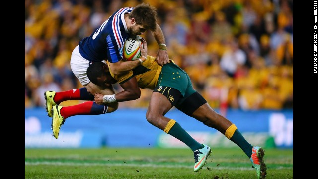Australia's Tevita Kuridrani tackles France's Hugo Bonneval during the first match of a three-match rugby series Saturday, June 7, in Brisbane, Australia. Australia won the opener 50-23. See 39 amazing sports photos from last week