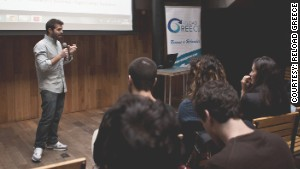 Thomas Douzis speaks at a Reload Greece conference.