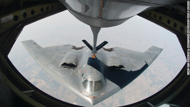A KC-135 Stratotanker refuels a B-2 during a training mission in August 2012. The B-2 is powered by four General Electric F118-GE-100 engines, and it can travel 6,000 miles without refueling.