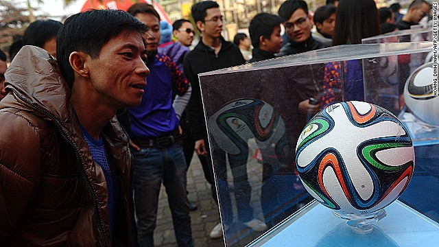 The Brazuca has already been in the limelight as the support act on the World Cup Trophy Tour. Here fans in the Vietnamese capital of Hanoi take a close look at the official ball.