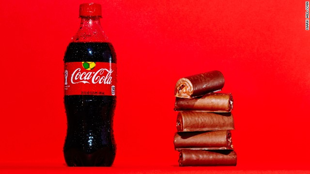 Soda: Coca-Cola. A 20-ounce bottle of Coca-Cola Classic contains 65 grams of sugar, which is the same amount of sugar found in five Little Debbie Swiss Rolls.