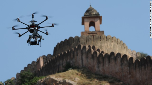 "A drone fitted with a film camera shoots aerial footage during the production of the film ""The Girl with the Indian Emerald"" in Jaipur, India, on November 7, 2012. While it's already being done in other countries, the U.S. government is considering <a href='http://www.cnn.com/2014/06/04/tech/innovation/movies-drones-faa/index.html'>a request from movie and TV producers</a> to let them use unmanned aircraft to shoot aerial video."