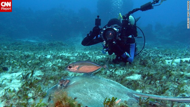 Diver Adam Puche takes a photo of a <a href='http://ireport.cnn.com/docs/DOC-759851'>southern stingray</a> with his diving mate in the background in Cozumel, Mexico.