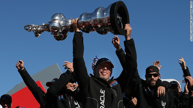 Larry Ellison holds the coveted cup aloft after defeating Emirates Team New Zealand in a thrilling comeback last year.