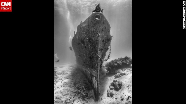 <a href='http://ireport.cnn.com/docs/DOC-1141527'>Christian Baki's </a>wife claims her spot on top of the Felipe Xicotencatl shipwreck during a dive in Cozumel, Mexico.
