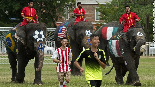 Elephants in Thailand's Ayutthaya province take part in a match with students in honor of the upcoming World Cup.