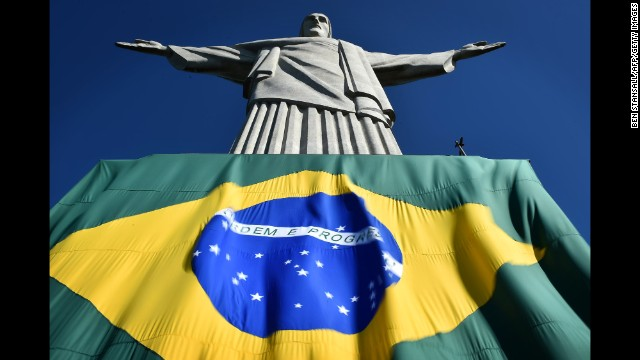The Brazilian flag is seen at the base of the Christ the Redeemer statue in Rio de Janeiro.
