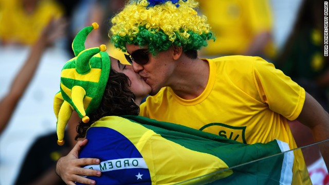 Brazil fans kiss before the opening soccer match.