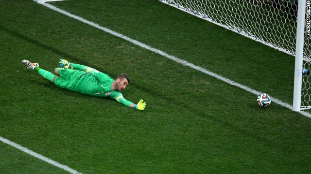 Croatia goalkeeper Stipe Pletikosa dives but fails to stop the ball as Neymar scores a first-half goal to tie the game at 1-1.