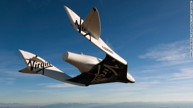 When the spacecraft is complete, it will look very similar to this SpaceShipTwo seen gliding over Mojave, California, in 2010. Virgin Galactic says its first commercial flights could begin as soon as this year.
