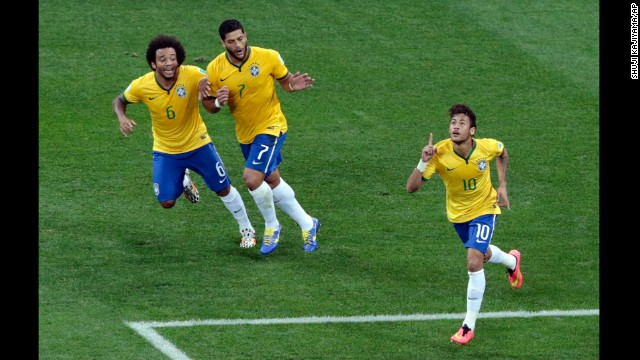 Neymar, right, celebrates his first-half goal with teammates Marcelo, left, and Hulk.