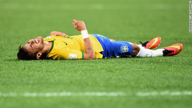 Neymar lies on the field during the first half.