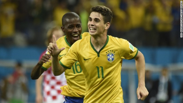 Brazilian midfielder Oscar, right, celebrates after scoring a late goal to give his team a 3-1 win over Croatia in the opening match of the World Cup on Thursday, June 12.