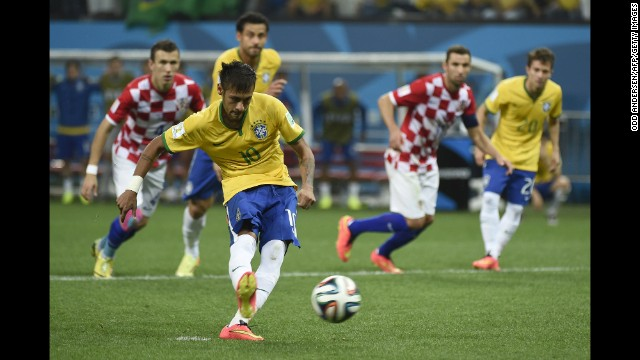 Brazil forward Neymar strikes the ball to score a penalty and give his team a 2-1 lead in the second half against Croatia.