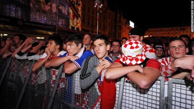 Croatian fans look despondent as they watch the opening match in Zagreb, Croatia.