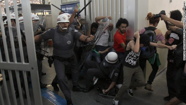 Protesters clash with police in Tatuape subway station, east of Sao Paulo, Brazil, on June 12.
