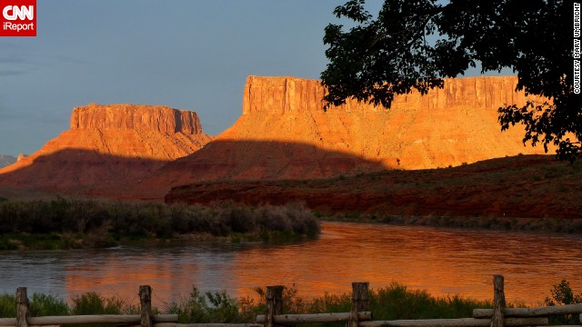 A warm sunset falls on the Red Cliffs of Moab, Utah. Mary Umbricht took this photo while on vacation and says the area is just magical. Visitors can also do some sightseeing at Arches and Canyonlands National Parks, which are nearby.
