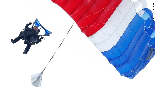 Bush floats to the ground Thursday, June 12, during a tandem parachute jump near his home in Kennebunkport, Maine. Bush was strapped to Mike Elliott, a retired member of the Army's Golden Knights parachute team, as he made the jump to celebrate his 90th birthday.