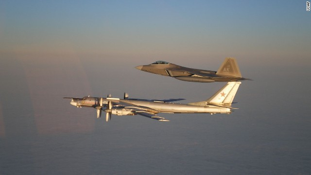 A U.S. Air Force F-22 Raptor, top, escorts a Russian Air Force Tu-95 bomber off the coast of Alaska during 2011.