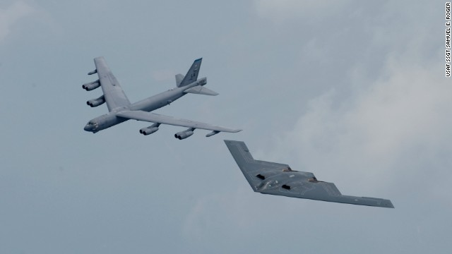 A B-52, left, and a B-2 stealth bomber fly in formation over Shreveport, Louisiana. The United States deployed both types of aircraft to Britain this month.