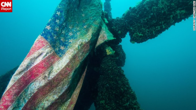 While diving in Dutch Springs in Bethlehem, Pennsylvania, <a href='http://ireport.cnn.com/docs/DOC-1142723'>Christian Baki</a> found this American flag still attached to a Sikorsky H-37 helicopter that was submerged in the freshwater quarry.