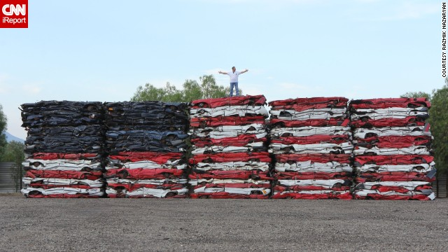 Talk about patriotism, <a href='http://ireport.cnn.com/docs/DOC-999591'>Razmik Nazaryan</a> made this colossal American flag with 108 crushed cars. The artist works in auto recycling and was inspired to create his masterpiece in July 2013.