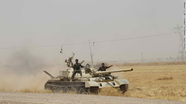 Kurdish Peshmerga forces, along with Iraqi special forces, deploy their troops and armored vehicles outside of Kirkuk, Iraq, on June 12.