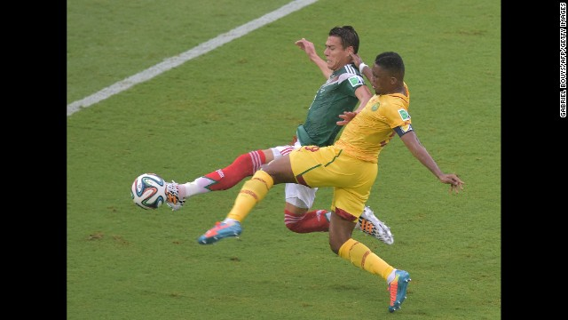 Moreno, in green, knocks the ball away from Cameroon forward Samuel Eto'o.