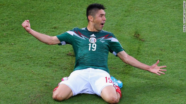 Oribe Peralta celebrates after scoring the only goal in Mexico's 1-0 win over Cameroon in Natal, Brazil.