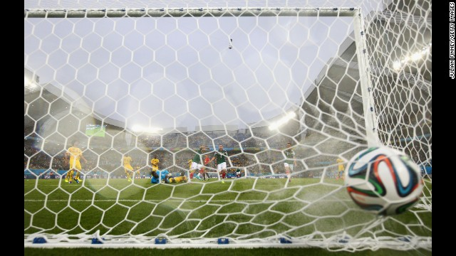 The ball sits in the back of the net after Peralta's goal.
