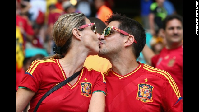 Two Spain fans kiss before the match.