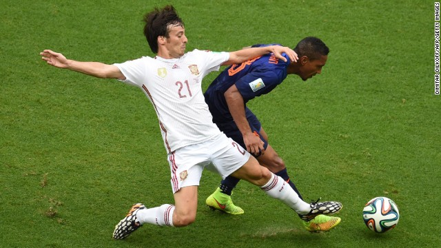 Spain's David Silva, left, vies with Dutch midfielder Jonathan de Guzman.