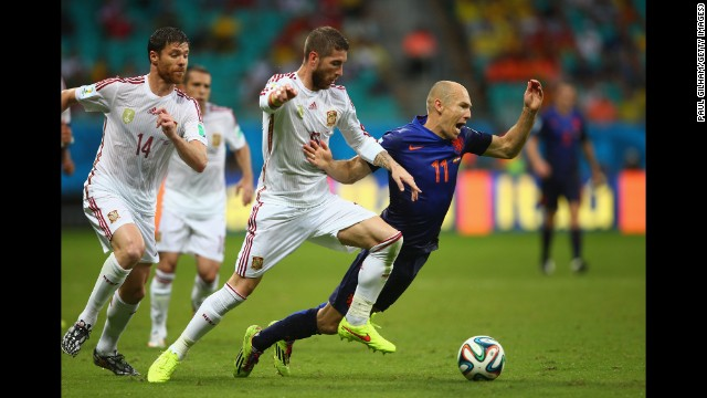 Robben is felled by Sergio Ramos of Spain.