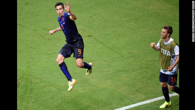 Netherlands forward Robin van Persie, left, celebrates after scoring his second goal of the match to put the Dutch up 4-1.
